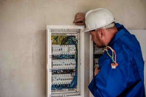 A picture of an electrician conducting an electrical inspection