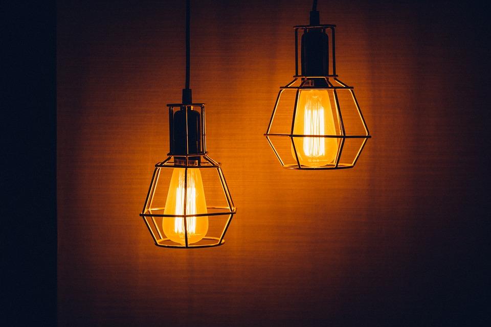 an image of two hanging light bulb fixtures