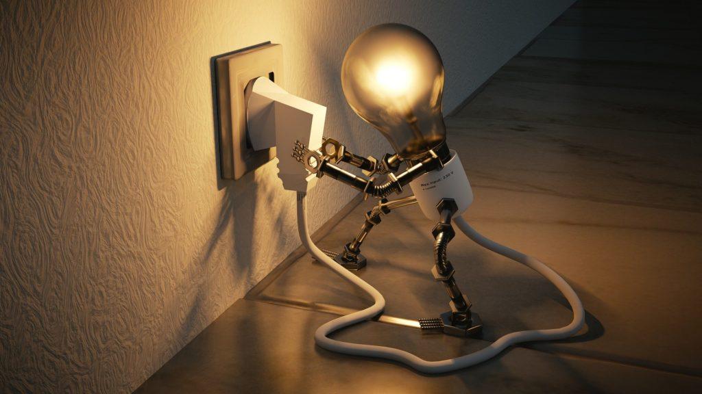 an image of a light bulb plugging itself into a plug socket